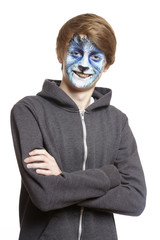 Teenage boy with face painting wolf