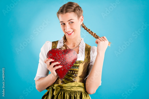 Young woman in traditional clothes - dirndl or tracht