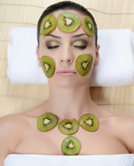 The girl with a mask from kiwi on the face