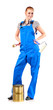 Young woman in blue overalls with painting tools