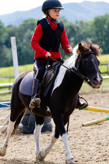 Horse riding, gallop -  lovely equestrian on a pony