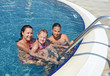 woman and her little cute daughter have a fun in pool outdoor