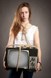 girl holding retro television