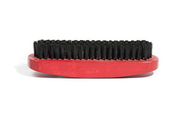 wooden brush for clothes, red and black, isolated