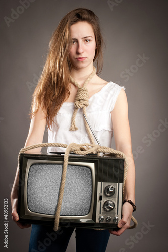 girl holding retro television