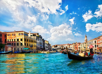 Venice Grand canal with gondolas and Rialto Bridge, Italy
