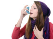 Woman with asthma using an asthma inhaler