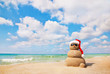 Sand snowman in santa hat. Holiday concept can be used for New Y