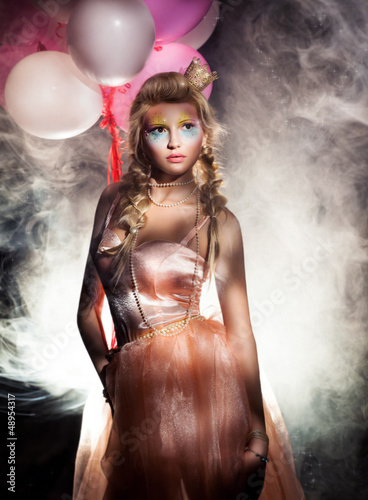 Beautiful Princess in Pink Dress with Golden Crown. Haze