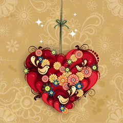 Heart decorated with flowers and birds