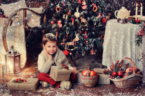 sitting on the floor of a handsome boy with gifts and baskets at