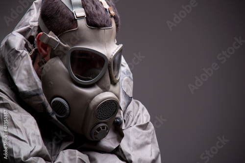 Man in protective mask on gray background