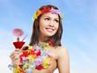 Woman in hawaii costume drink  juice.