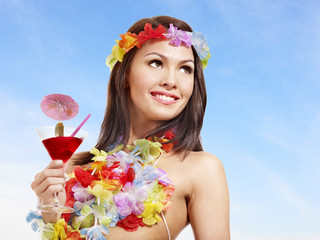 Woman in hawaii costume drink  juice.
