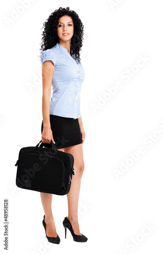 Businesswoman full length holding a briefcase