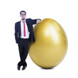 Businessman and golden egg