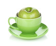 Ripe green apple in tea cup