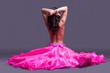 topless dancer in pink costume sitting on floor
