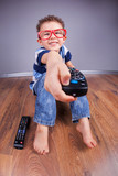 Cheerful child with tv remote control