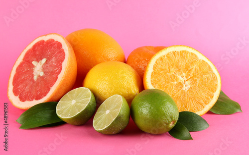 Fruits with leafs on pink background
