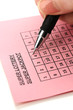 Closeup of lotto ticket during the marking of numbers