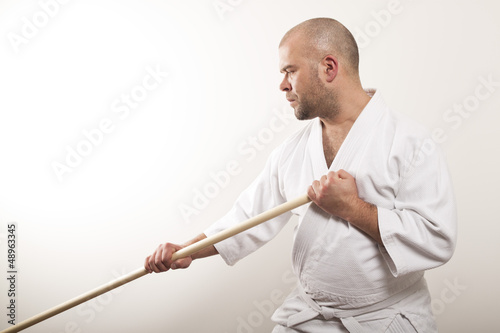 Aikido man with a stick
