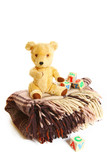 Blanket, teddy bear and wooden cubes isolated on white