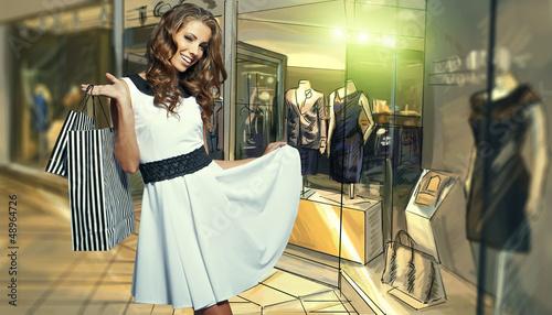 Beautiful shopping woman at a draw store