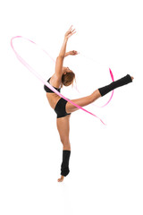 Gymnast woman dancer posing with ribbon over white.