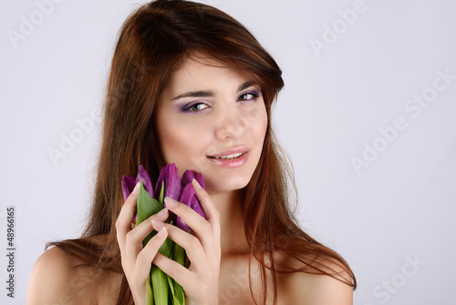tender girl with tulips
