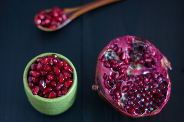 Pomegranate seeds portion in green pottery