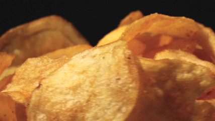 Potato chips in rotation. Macro Horizontal view