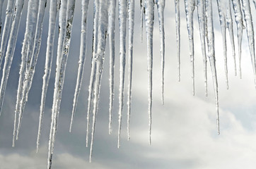 Beautiful icicles on a background of clouds