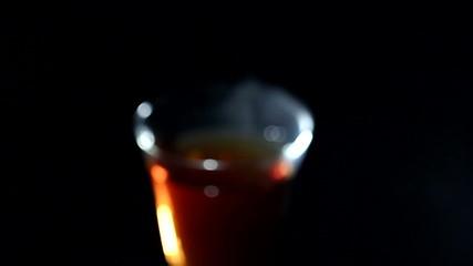 Glass of hot tea in rotation. Blurred scene
