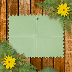 Grunge paper with bunch of flower on the wooden background