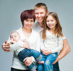 Nice smiling family looking at the camera