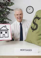 Mortgage Broker Sitting At Desk