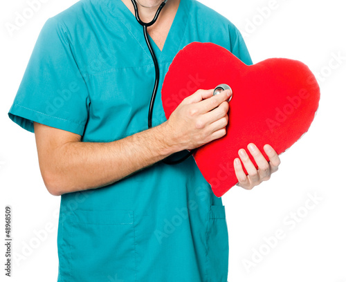 doctor examining a red heart