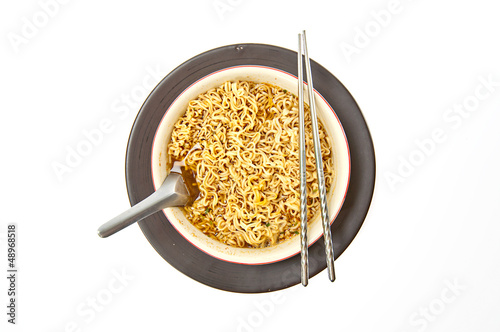 Instant noodle and chopsticks isolated with path on white backgr