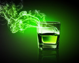 Glass of green absinth