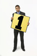 Businessman Holding A Poster With A Number 1
