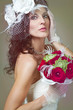 Beautiful bride with red roses.