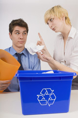 Woman Scolding Man For His Recycling Habits