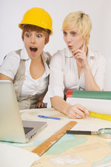 Two Surprised Women Looking At Laptop