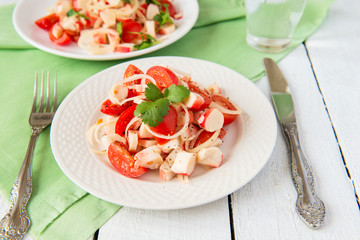 Salad from crabmeat sticks and tomatoes