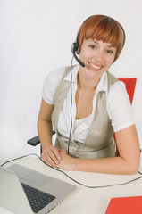 Woman On Headset Connected To Laptop