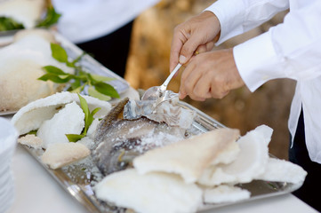 Waiter serving a tasty fish