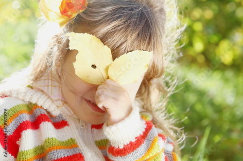 Little Girl Hiding Behind the Leaf on Sunny Day