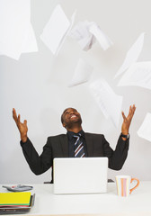 Businessman Tossing Papers In The Air