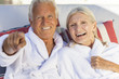 Happy Senior Couple In Bathrobes at Health Spa